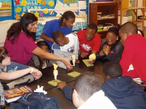 Colleague Devaleena Pradhan (left)  compares and contrasts brain models with middle school students.